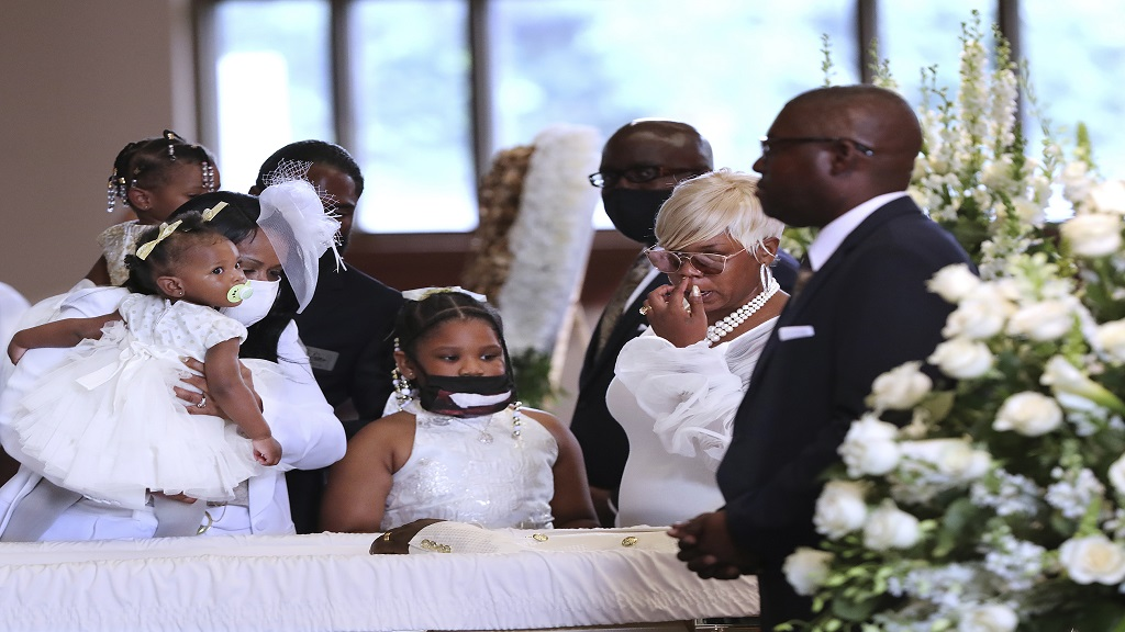 Tomika Miller, wife of Rayshard Brooks, and family members all dressed in white pause during the family processional at his funeral in Ebenezer Baptist Church on Tuesday, June 23, 2020 in Atlanta. Brooks, 27, died June 12 after being shot by an officer in a Wendy's parking lot. Brooks' death sparked protests in Atlanta and around the country. (Curtis Compton/Atlanta Journal-Constitution via AP, Pool)