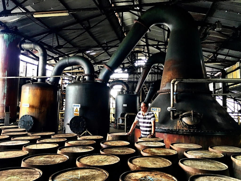 Andrew Hussey, CEO of Hussey Group of Companies, the owners of Hampden Estate Distillery stands with several barrels of rum at the company's plant in Trelawny.