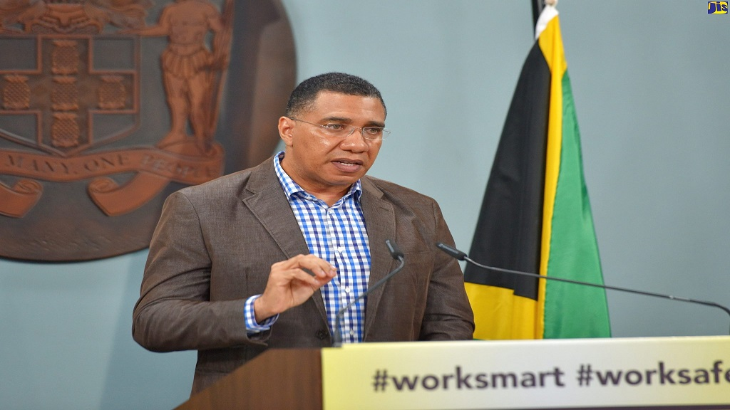 Prime Minister Andrew Holness at a Jamaica House COVID-19 press conference on Friday.