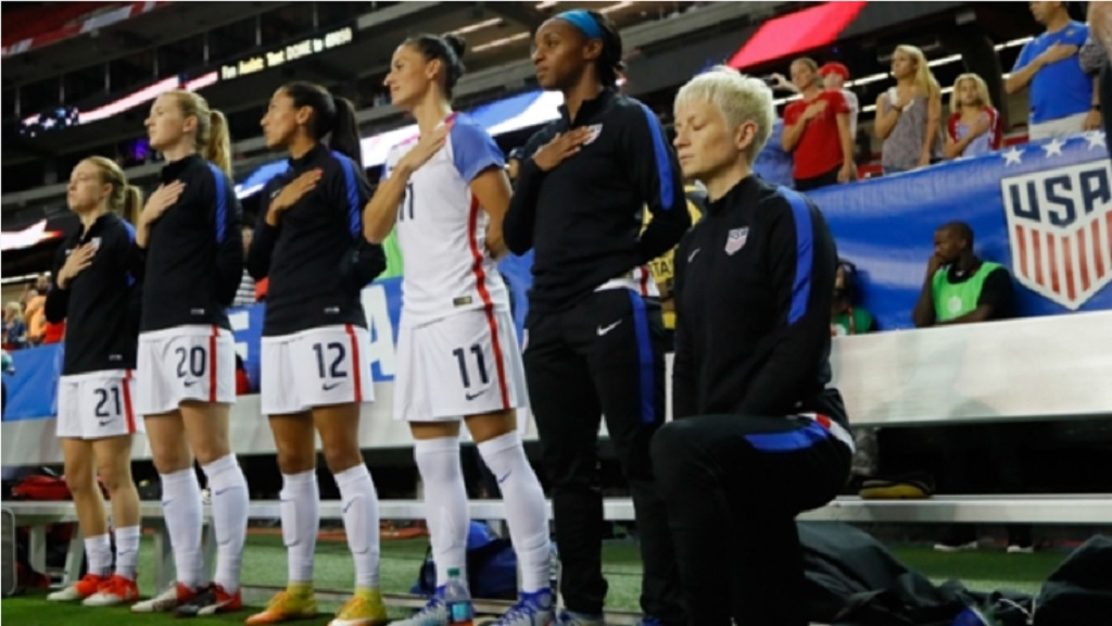 Megan Rapinoe (right) kneels during the anthem in 2016.