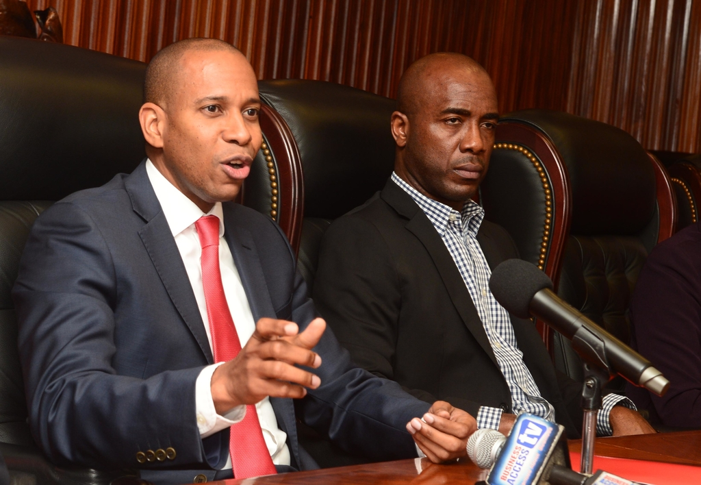 File photo shows Scotia Group Jamaica's President and CEO David Noel (left) and Dr Adrian Stokes, Senior Vice President & Head of Insurance and Wealth Management.