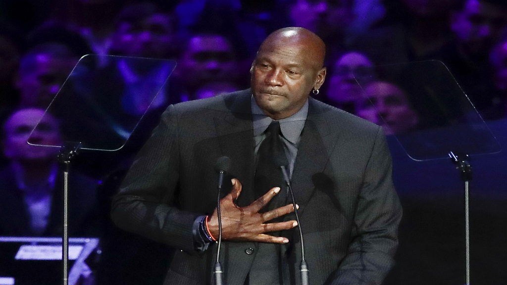 In this Feb. 24, 2020, file photo, former NBA player Michael Jordan reacts while speaking during a celebration of life for Kobe Bryant and his daughter Gianna in Los Angeles. (AP Photo/Marcio Jose Sanchez).