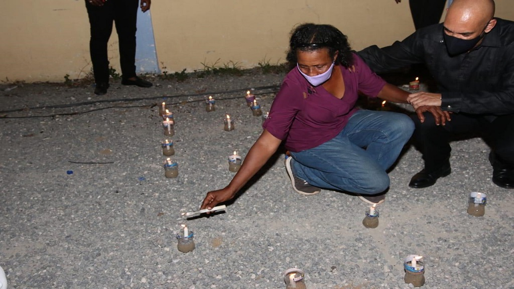 Candles being lit at a vigil that was held for the two police officers who were killed in a gun attack in Horizon Park, Spanish Town, St Catherine on June 12. At right is Police Commissioner, Major General Antony Anderson.