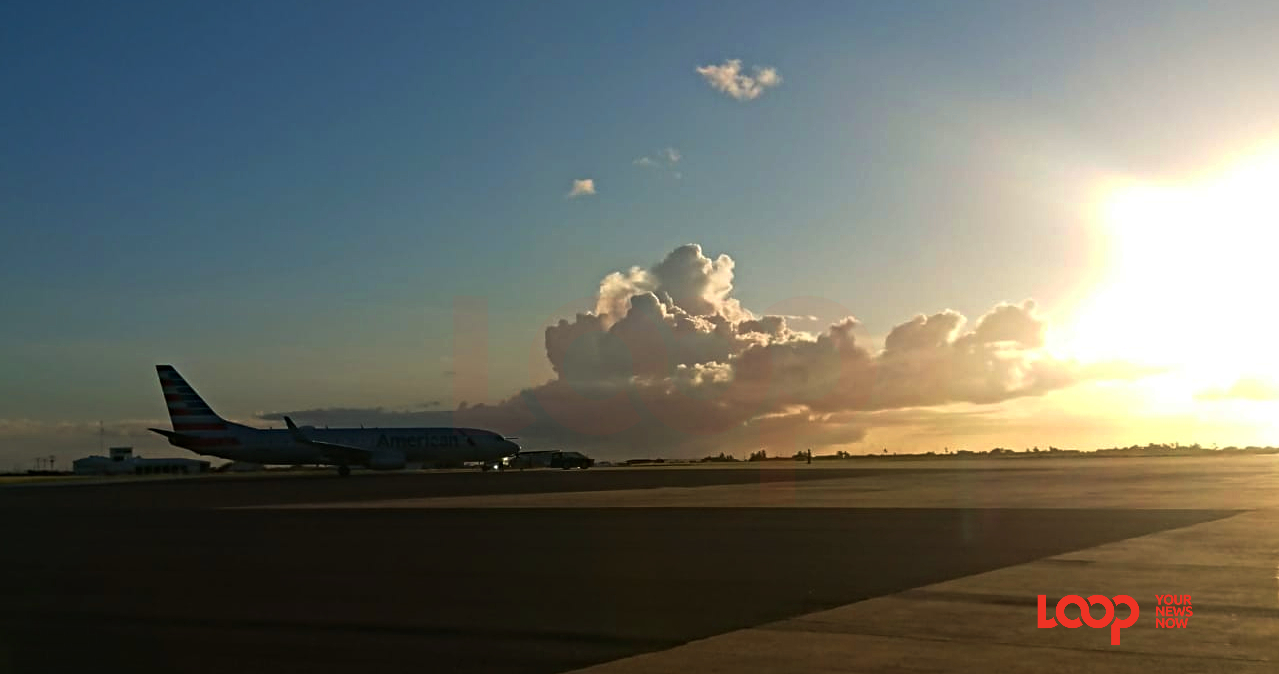 American Airlines flight at Barbados' Grantley Adams International Airport at sunset on November 15, 2019.