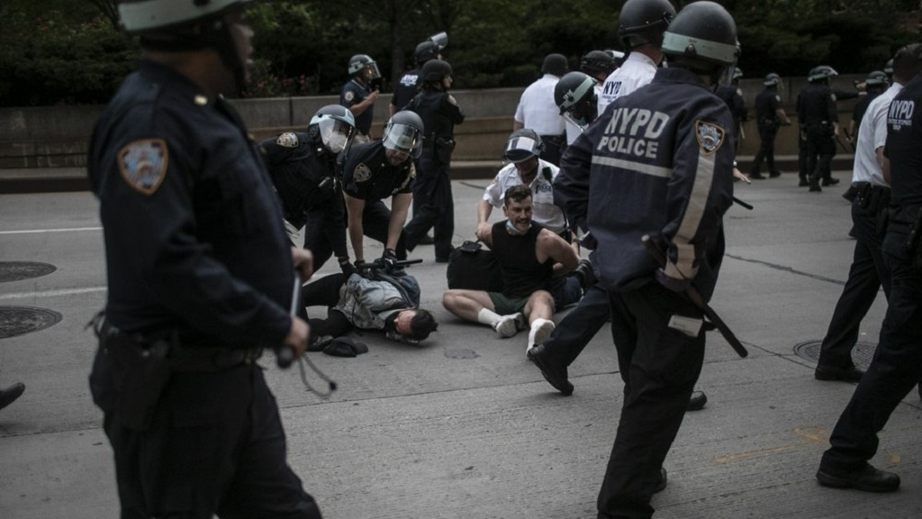 Police arrest protesters refusing to get off the streets during an imposed curfew while marching in a solidarity rally calling for justice regarding the death of George Floyd, Tuesday, June 2, 2020, in New York. Floyd died after being restrained by Minneapolis police officers on May 25. (AP Photo/Wong Maye-E)