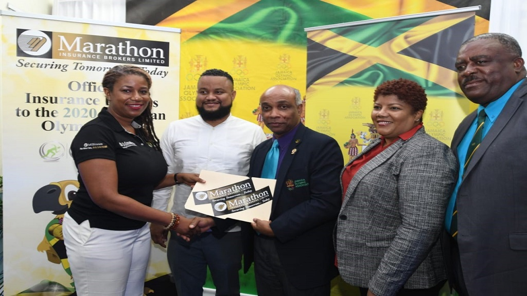 JOA President Christopher Samuda (centre), Secretary General/Chief Executive Officer Ryan Foster (second left) and fellow Directors Nicole Chase, President Jamaica Badminton Association and Raymond Anderson (right), accept a sponsorship cheque from Marathon Insurance Brokers' Keisha Burgher, Executive Director, to aid the development of its affiliates.