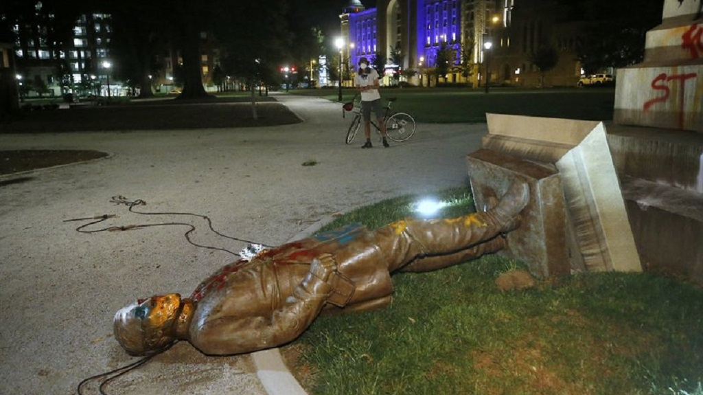The statue of Confederate Gen. Williams Carter Wickham lies on the ground after protesters pulled it down Saturday, June 6, 2020, in Monroe Park in Richmond, Va. The statue had stood in the park since 1891. (Alexa Welch Edlund/Richmond Times-Dispatch via AP)