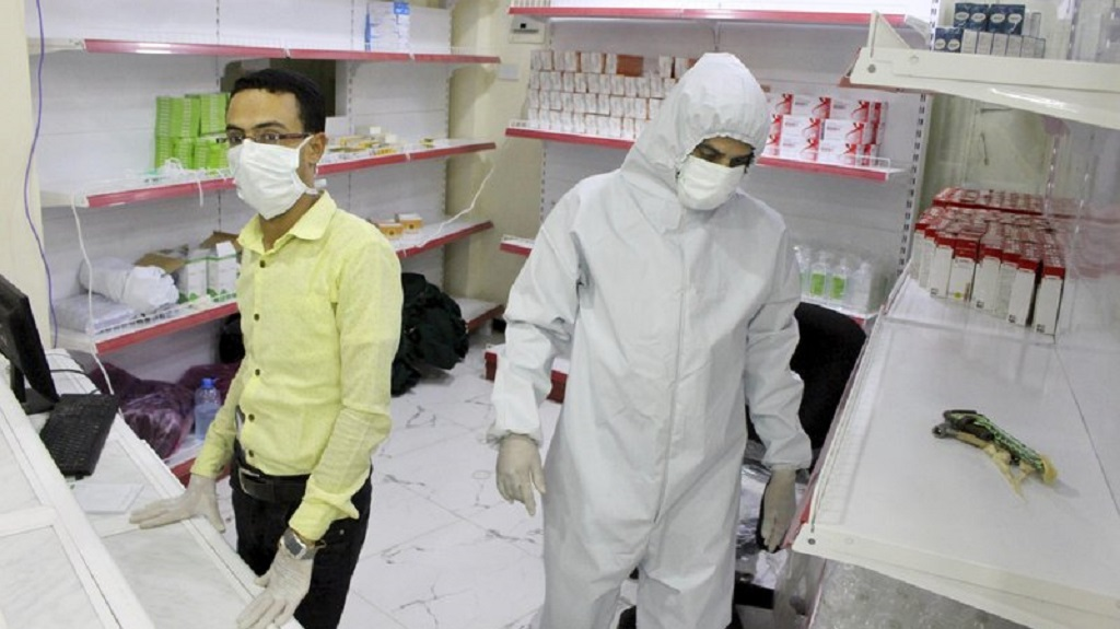 FILE - In this May 12, 2020 file, photo, Yemeni medical workers wearing masks and protective gear stand at the entrance of a hospital in Aden, Yemen. (AP Photo/Wail al-Qubaty, File)