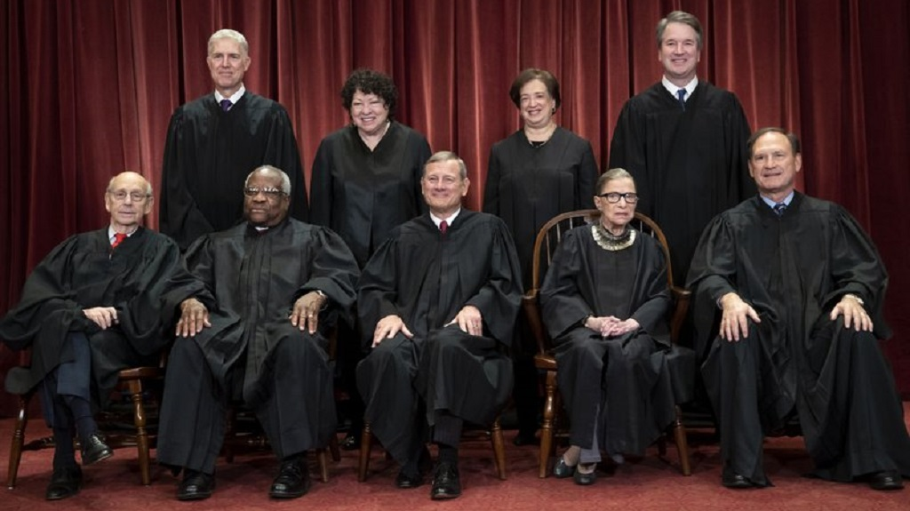 Seated from left: Associate Justice Stephen Breyer, Associate Justice Clarence Thomas, Chief Justice of the United States John G. Roberts, Associate Justice Ruth Bader Ginsburg and Associate Justice Samuel Alito Jr. Standing behind from left: Associate Justice Neil Gorsuch, Associate Justice Sonia Sotomayor, Associate Justice Elena Kagan and Associate Justice Brett M. Kavanaugh. (AP Photo/J. Scott Applewhite, File)