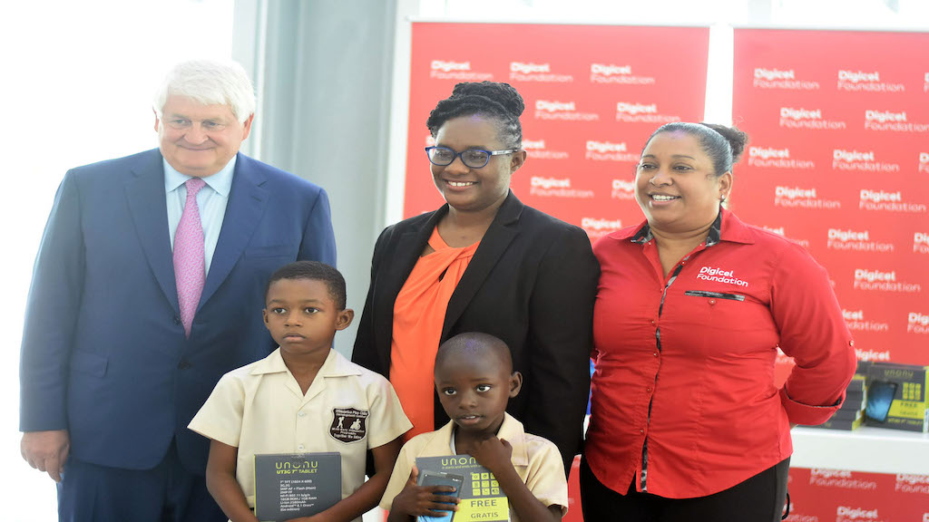 (From left) Denis O'Brien, founder and patron of the Digicel Foundation; student Kyle Adamson; executive director of the JCPD, Christine Hendricks; student Jahvar Campbell and Digicel Foundation CEO Charmaine Daniels at the presentation ceremony.