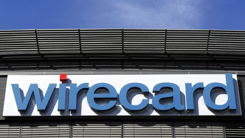 Shares in German payment service provider Wirecard AG plunged Thursday as the company announced it was postponing its delayed annual report yet again. (AP Photo/Matthias Schrader, file)