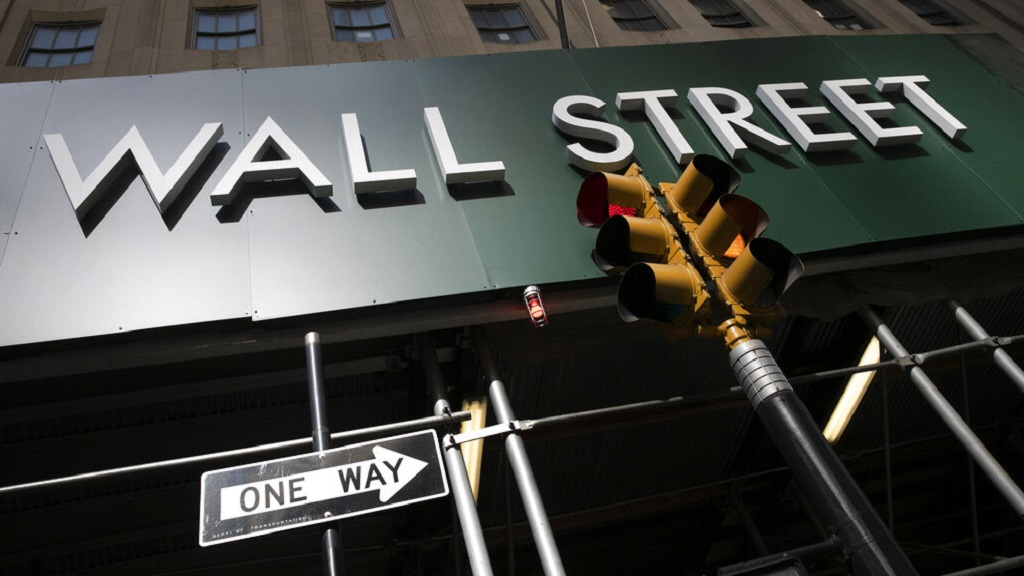 A sign for a Wall Street building is shown, Tuesday, June 16, 2020.  (AP Photo/Mark Lennihan)