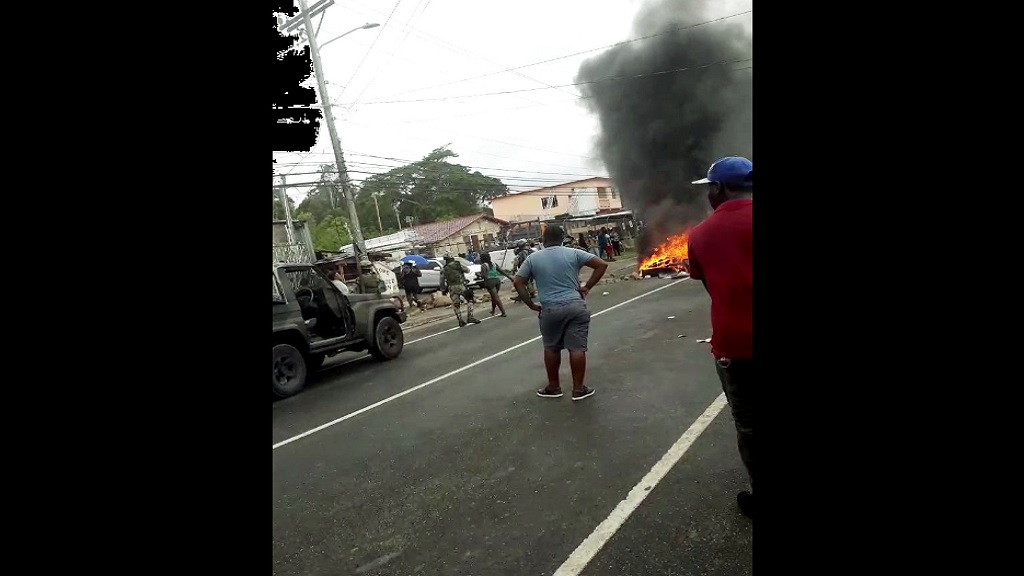 A screengrab from a  video showing members of the Jamaica Defence Force (JDF) at the scene of a protest over the fatal shooting of a man in Stewart Town, St Mary on Monday.