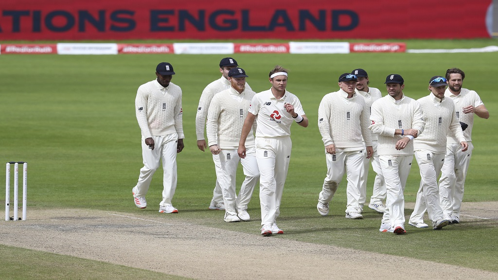 England's Stuart Broad, fourth left, and teammates walk off the field after their win on the fifth day of the deciding third cricket Test match against West Indies at Old Trafford in Manchester, England, Tuesday, July 28, 2020. (Martin Rickett/Pool via AP).