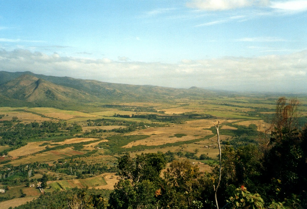 Panoramic view of the Valle De Los Ingenios, or Valley of the Sugar Mills, a series of three interconnected valleys about 12 kilometres outside of Trinidad, Cuba. The three valleys, were a centre for sugar production from the late 18th century until the late 19th century. 