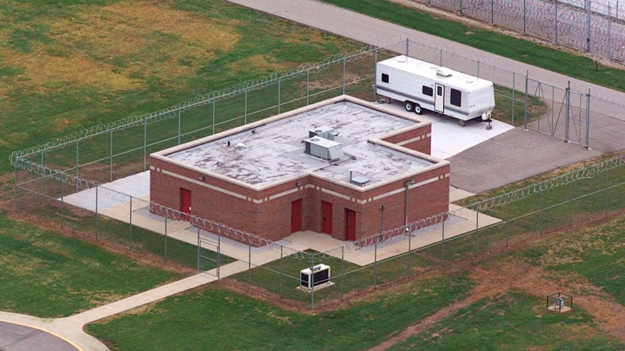 In this June 11, 2001 file photo, an aerial view of the execution facility at the United States Penitentiary in Terre Haute, Ind., is shown. After the latest 17-year hiatus, the Trump administration wants to restart federal executions this month at the Terre Haute, prison. Four men are slated to die. All are accused of murdering children in cases out of Arkansas, Kansas Iowa and Missouri. (AP Photo/Michael Conroy File