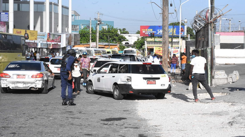 In this file photo, a police officer directs traffic on North Odeon Avenue in the Half Way Tree, St Andrew area.