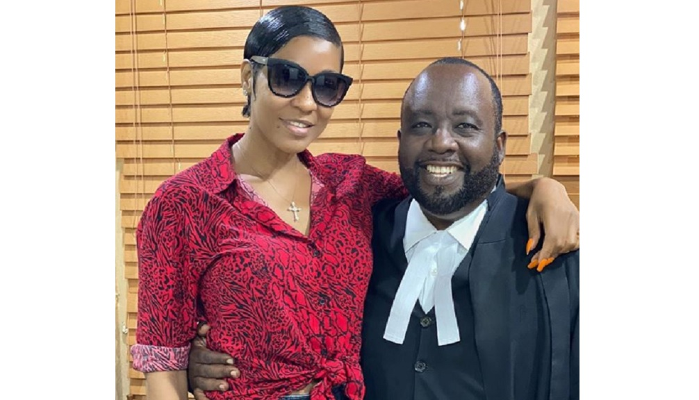 Dancehall artiste D'Angel with attorney Christopher Townsend.