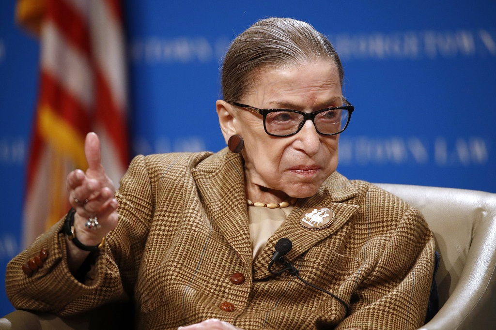 FILE - In this February 10, 2020, file photo US Supreme Court Associate Justice Ruth Bader Ginsburg speaks during a discussion on the 100th anniversary of the ratification of the 19th Amendment at Georgetown University Law Center in Washington. (AP Photo/Patrick Semansky, File)