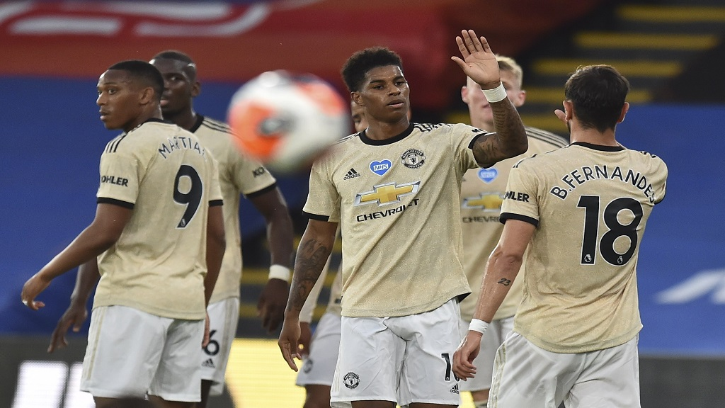 Manchester United's Marcus Rashford, centre, celebrates after scoring the opening goal during the English Premier League football match against Crystal Palace at Selhurst Park in London, England, Thursday, July 16, 2020. (AP Photo/Glyn Kirk, Pool).