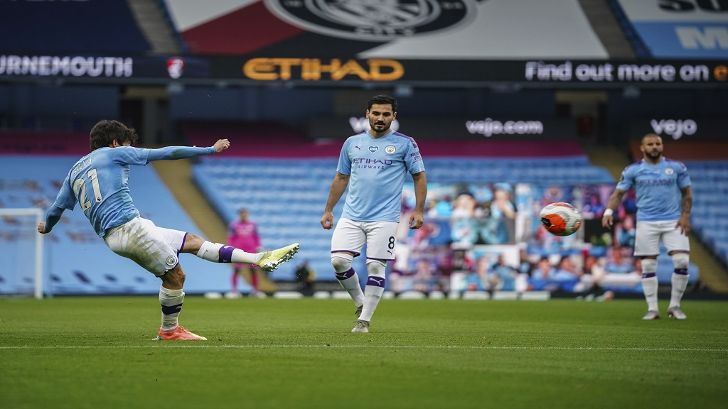 Manchester City's David Silva scores during the English Premier League football match against Bournemouth at the Ethiad Stadium in Manchester, England, Wednesday, July 15, 2020. (AP photo/Dave Thompson, Pool).