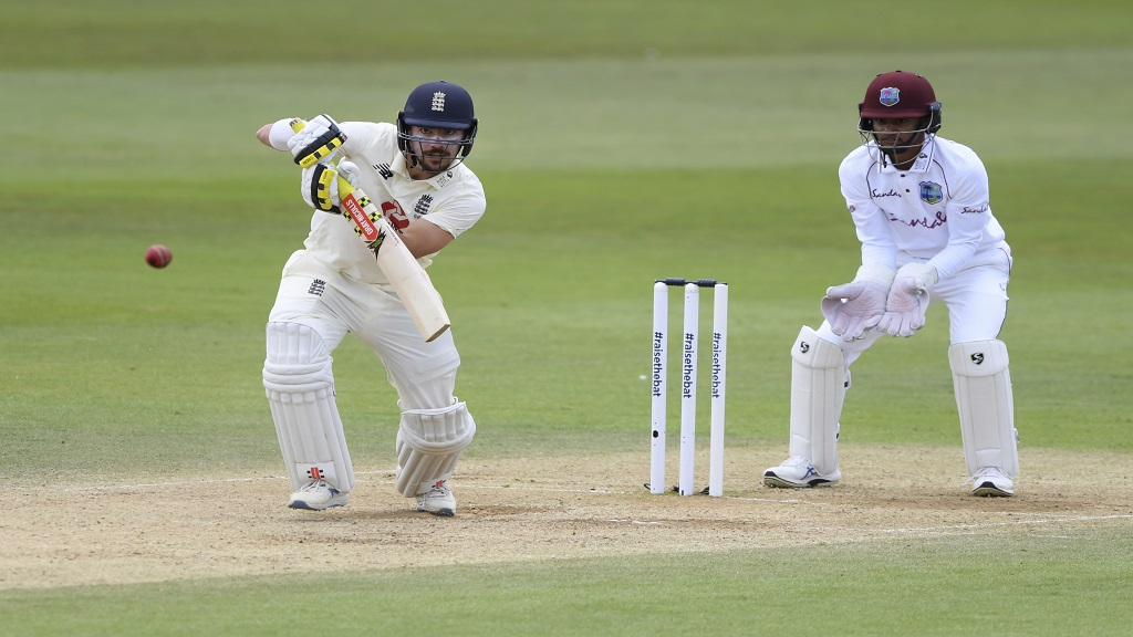 England's Rory Burns, left, bats during the fourth day of the first cricket Test match against West Indies, at the Ageas Bowl in Southampton, England, Saturday, July 11, 2020. (Mike Hewitt/Pool via AP).
