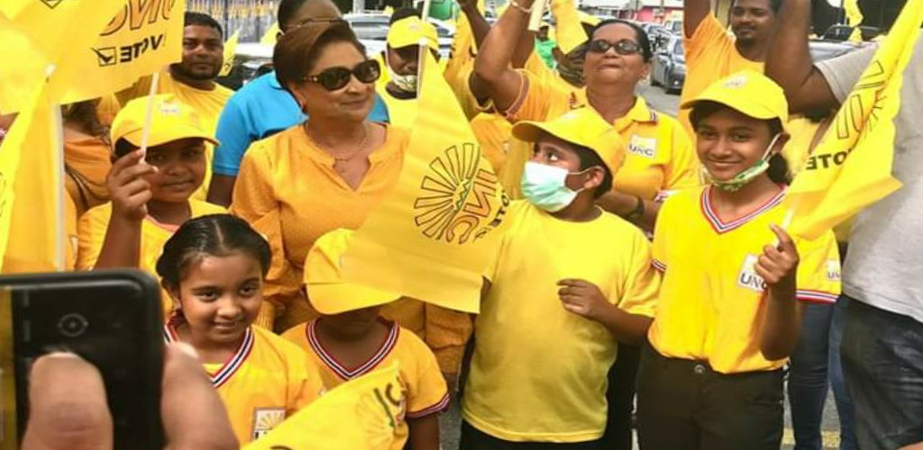 Pictured: UNC political leader surrounded by supporters during a recent motorcade in Siparia. Photo via Facebook, Kamla Persad-Bissessar