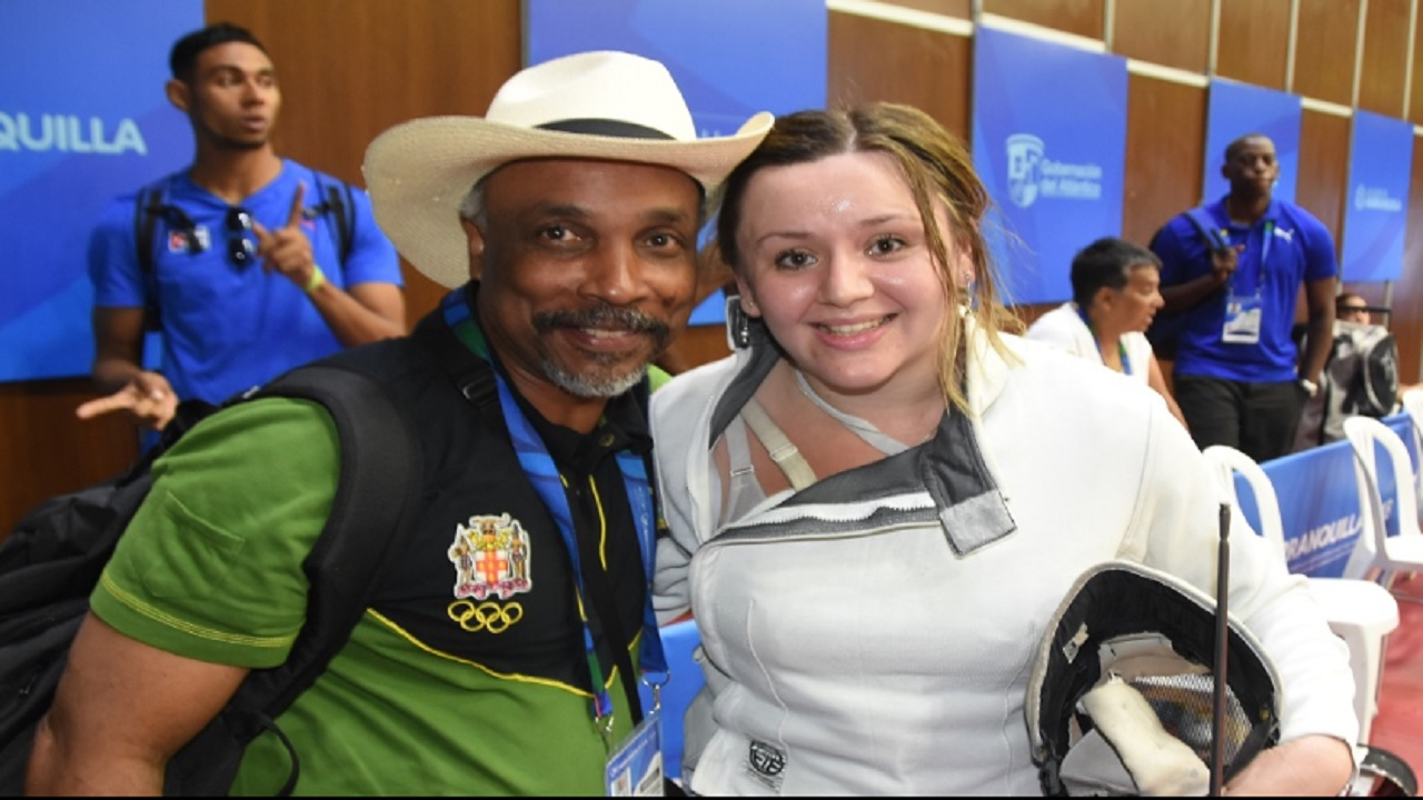 Jamaica Olympic Association (JOA) President, Christopher Samuda (left) congratulates Jamaica's Caitlin Chang after she won the silver medal in the women's fencing competition on July 28, 2018 at the Central American and Caribbean (CAC) Games in Barranquilla, Colombia.
