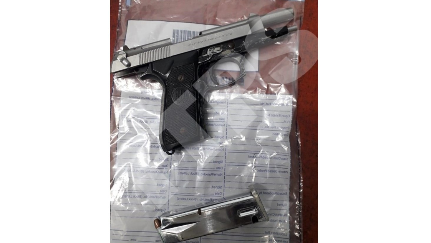 Police seized this 9mm Beretta pistol in Diego Martin.