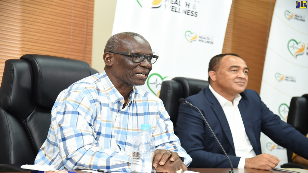 Minister of Local Government and Community Development, Desmond McKenzie (left), speaking on Thursday (July 16) during the Ministry of Health and Wellness' weekly virtual COVID Conversations press briefing. Listening is Minster of Health and Wellness, Dr Christopher Tufton.