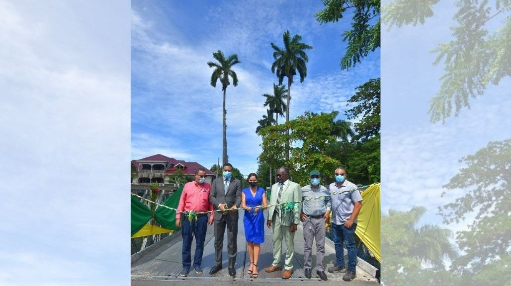 PM Andrew Holness (second left) and Portland Eastern MP Ann-Marie Vaz (third left) cut the ribbon to commission into service the new East Palm Bridge in Port Antonio, Portland, on Friday, July 24. Looking on (from left) are minister without portfolio in the Ministry of Economic Growth and Job Creation and Portland Western MP Daryl Vaz, Mayor of Port Antonio, councillor Paul Thompson, National Security Minister Dr Horace Chang, and Director/Project Manager at Chin's Construction, Alex Chin. (Photo: JIS)