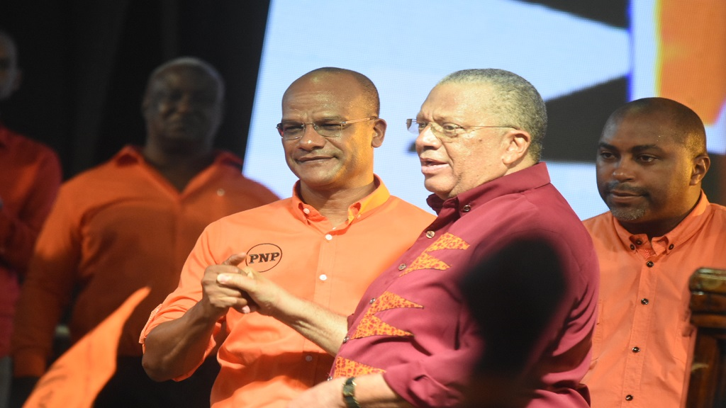 People's National Party (PNP) leader, Dr Peter Phillips (right), alongside Peter Bunting who last year challenged for the leadership, in a show of unity at the party's annual conference last September.