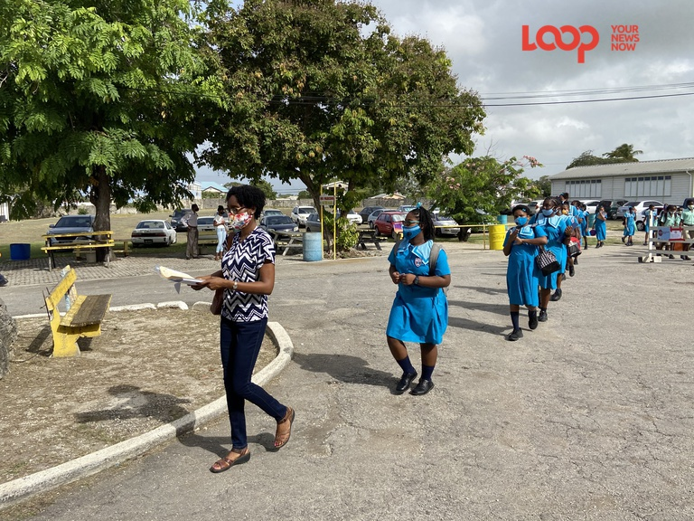Students set to take the Common Entrance examination make their way to their examination rooms at the Christ Church Foundation School.