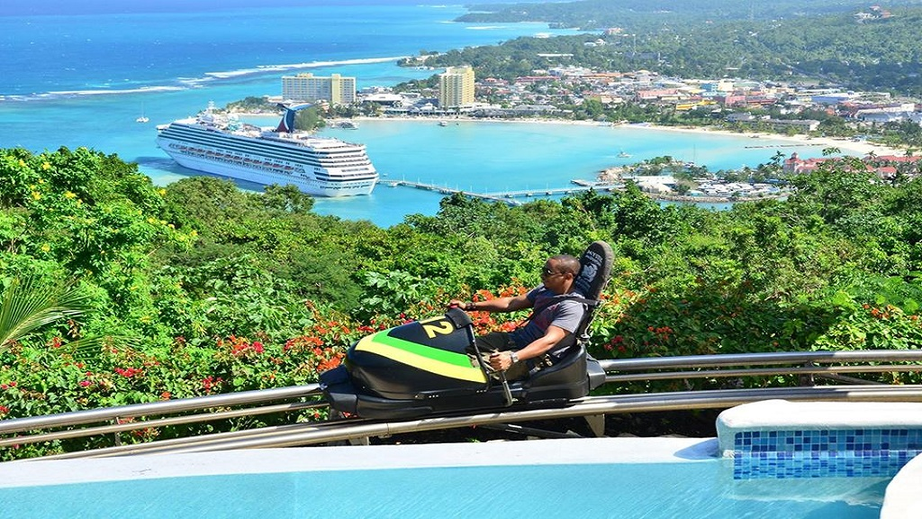 Riding the bobsled while enjoying the panoramic view of Ocho Rios. (Photo via Mystic Mountain, Facebook)