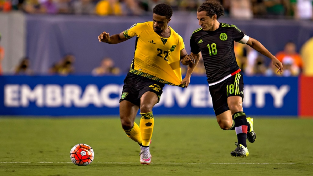 Garath McCleary of Jamaica (left) seeks for the ball against Mexico´s Andres Guardado in the 2015 Concacaf Gold Cup final at Lincoln Financial Field in Philadelphia on July 26, 2015. (PHOTO: Concacaf.com).