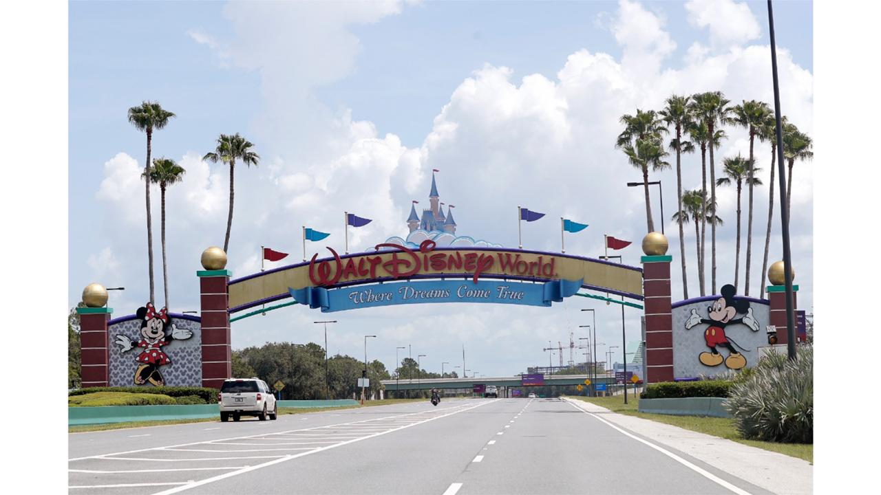 Cars drive under a sign greeting visitors near the entrance to Walt Disney World, Thursday, July 2, 2020, in Lake Buena Vista, Fla. Despite a huge surge of Floridians testing positive for the new coronavirus in recent weeks, Magic Kingdom and Animal Kingdom, two of Disney World's four parks are reopening Saturday, July 11.