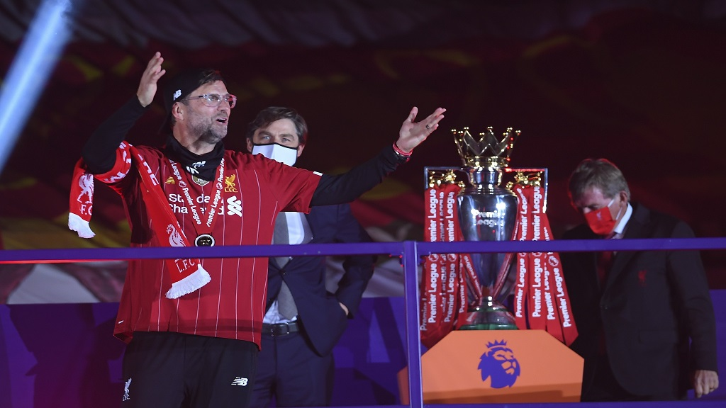 Liverpool's manager Jurgen Klopp celebrates after getting his winners medal following the English Premier League football match against Chelsea at Anfield Stadium in Liverpool, England, Wednesday, July 22, 2020. (Laurence Griffiths, Pool via AP).