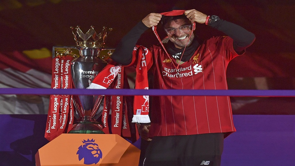 Liverpool's manager Jurgen Klopp puts on his winners' medal following the team's last home game of the English Premier League football season against Chelsea at Anfield Stadium in Liverpool, England, Wednesday, July 22, 2020.   Liverpool won the match against Chelsea 5-3. The Premier League trophy was also presented to Liverpool on the day. (Paul Ellis, Pool via AP).