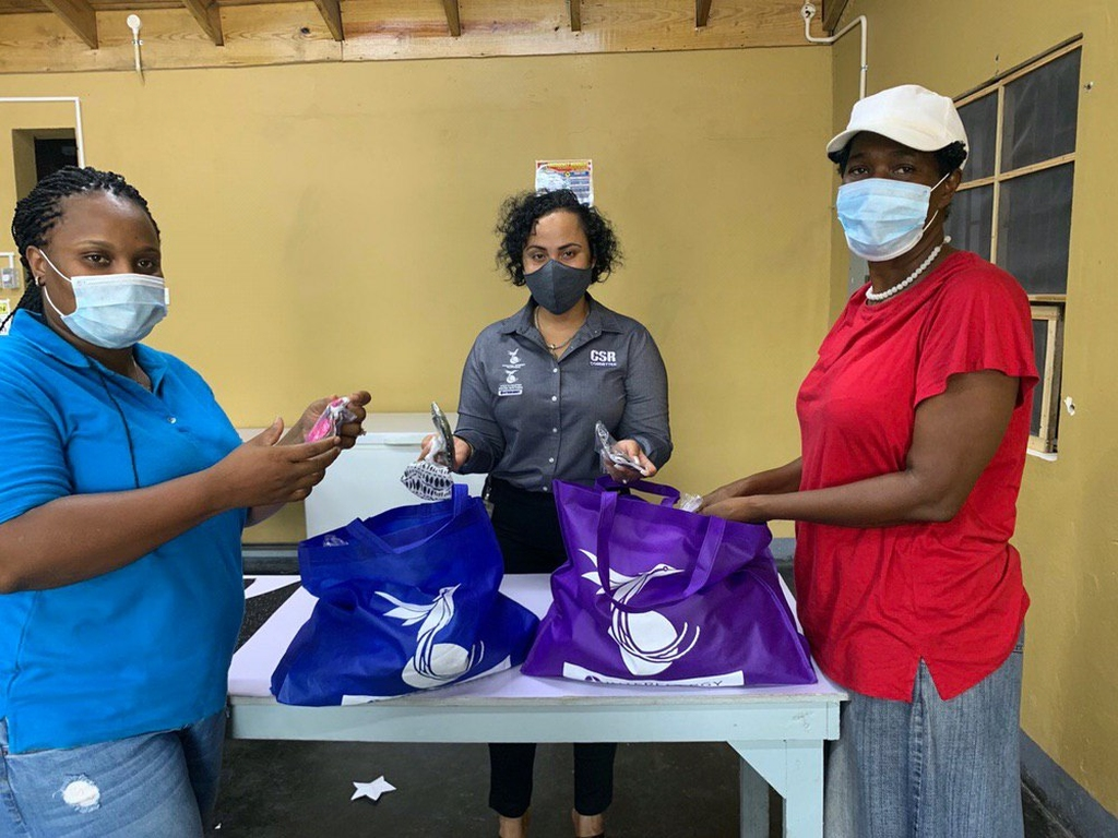 Corporate Responsibility Manager, Melissa Newman, journeyed to Old Harbour Bay  to hand over masks to Secretary of the OHB CDA, Chantel Davis (left), and Sandra Nembhard (right) for members of the community.