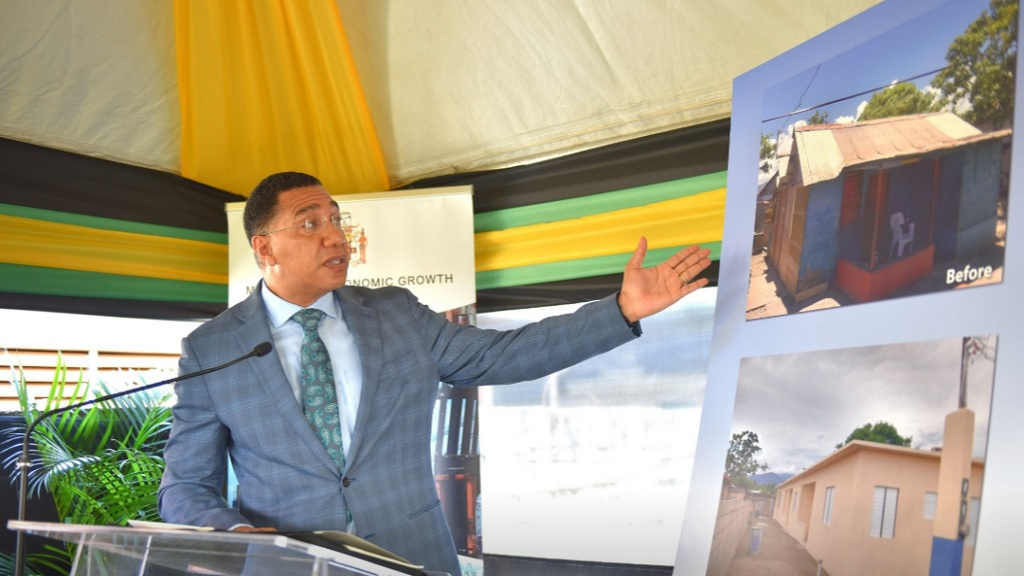 Prime Minister Andrew Holness at the handing over ceremony for a HOPE programme housing solution to three sisters and their families in Annotto Bay, St Mary last Thursday.