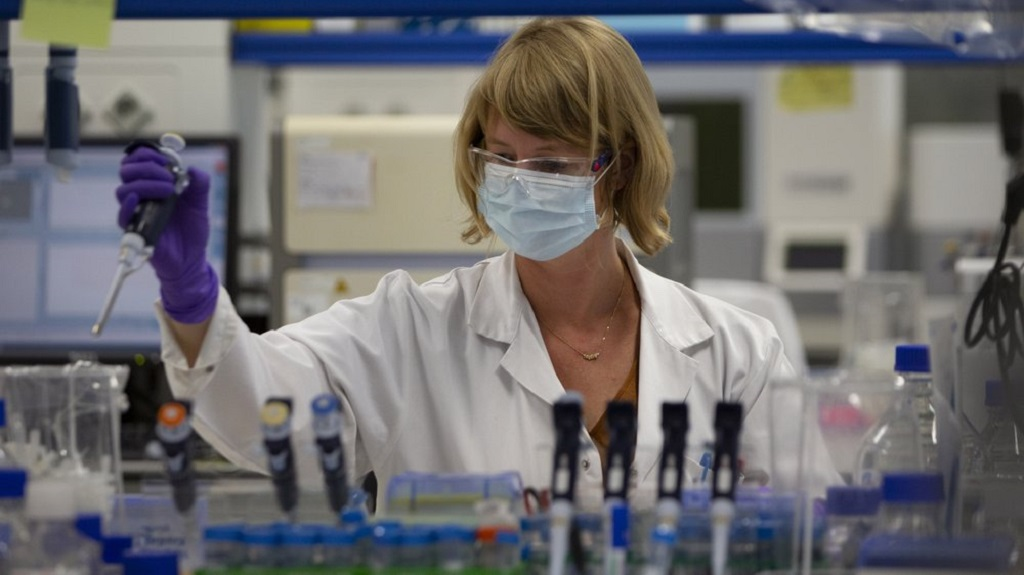 A lab technician works during research on coronavirus, COVID-19, at Johnson & Johnson subsidiary Janssen Pharmaceutical in Beerse, Belgium, Wednesday, June 17, 2020. Janssen Pharmaceutical hopes to begin clinical trials on a potential vaccine for COVID-19 in the middle of the summer. (AP Photo/Virginia Mayo)