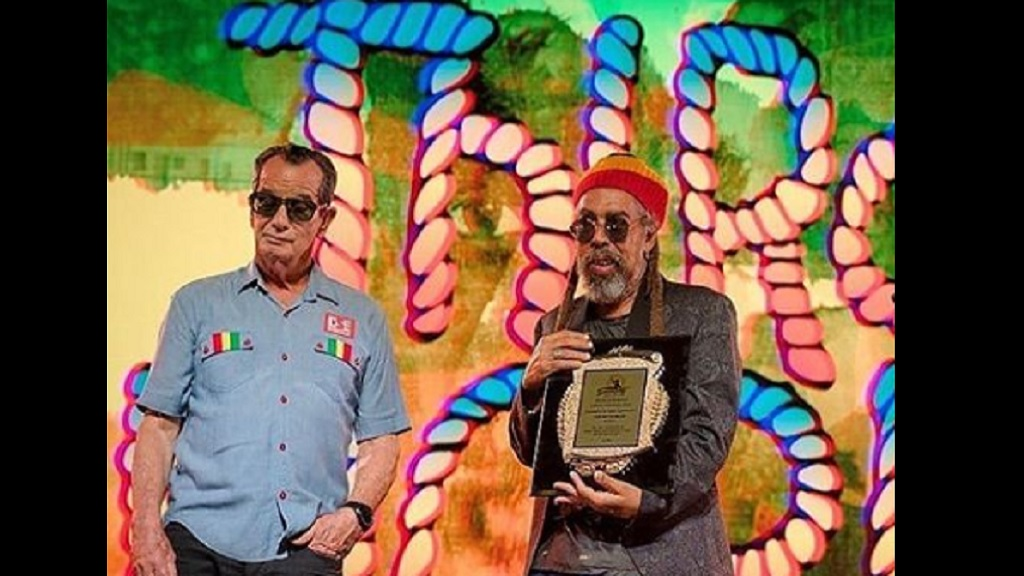 Founding Third World member Stephen 'Cat' Coore (right) with Reggae Sumfest executive director, Joe Bogdanovich, after collecting the Lifetime Achievement Award on behalf of the band. (Photo: Third World Instagram)