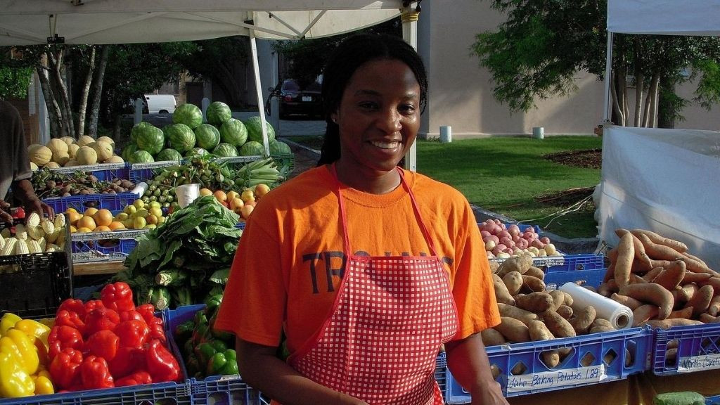 A woman at a farmer's market; Image source:  United States Department of Agriculture