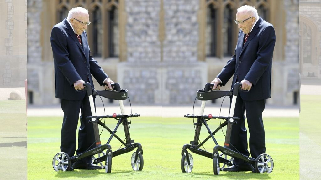 Captain Sir Thomas Moore arrives to receive his knighthood from Britain's Queen Elizabeth, during a ceremony at Windsor Castle in Windsor, England. Captain Sir Tom raised almost £33 million for health service charities by walking laps of his Bedfordshire garden. (Chris Jackson/Pool Photo via AP)