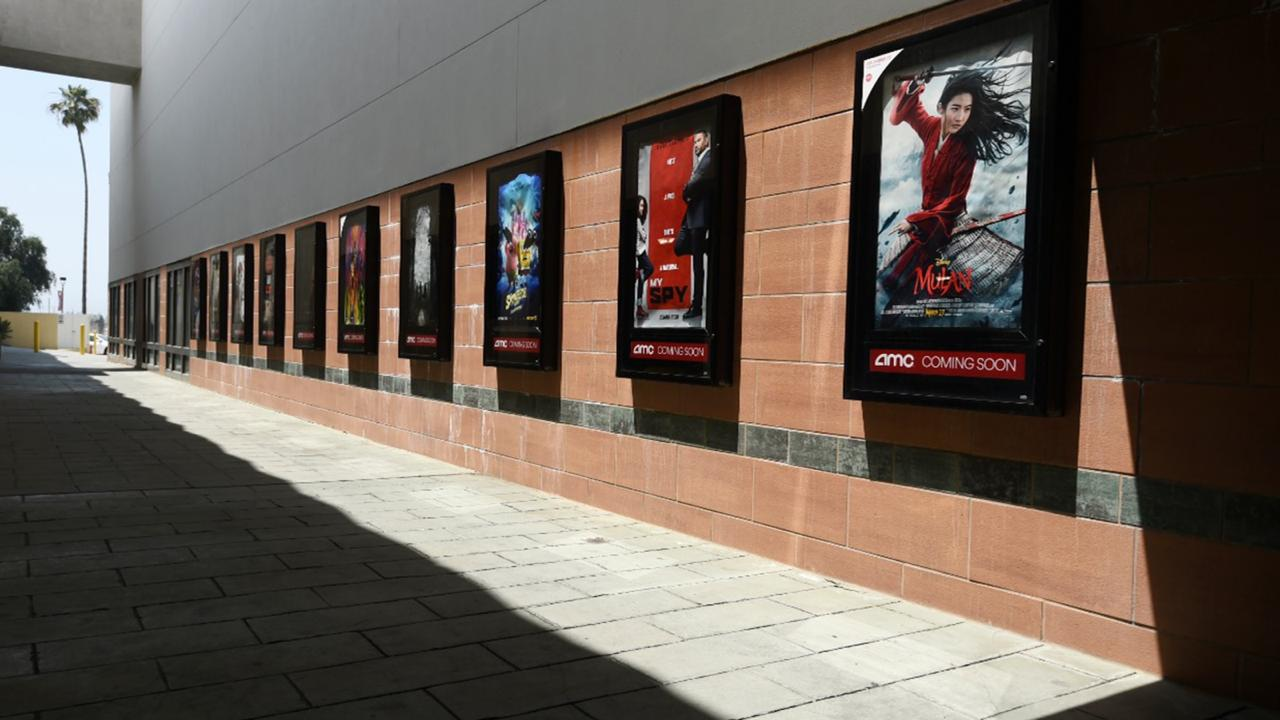 Posters for upcoming movies are displayed in an empty corridor at the currently closed AMC Burbank Town Center 8 movie theaters complex on April 29, 2020, in Burbank, Calif.  (AP Photo/Chris Pizzello, File)