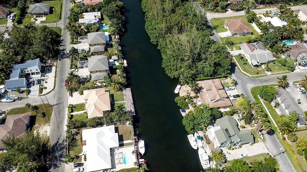 The townhouses will be developed on close to an acre of land directly on the canal at Omega Drive, Grand Cayman.