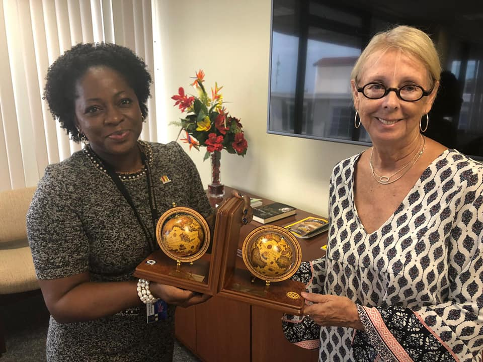 President Stacy Parke presenting IPP Pat Steward with a beautiful pair of bookends that were embellished with the Rotary emblem and personalised to mark the last Rotary Sunrise year of leadership.