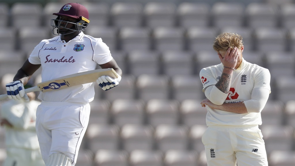 England captain Ben Stokes (right) reacts after West Indies captain Jason Holder (left) hit a boundary from his delivery during the fifth day of the first cricket Test match between England and West Indies at the Ageas Bowl in Southampton, England on Sunday, July 12, 2020. (Adrian Dennis/Pool via AP)