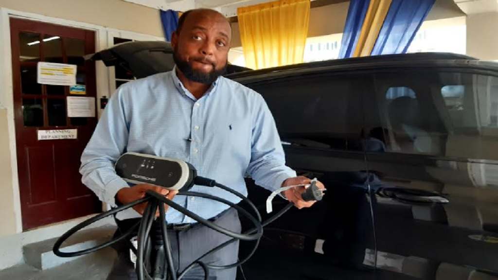 Michael Belnavis with the vehicle charging port after it was recently dismantled at the St Ann Municipal Corporation.