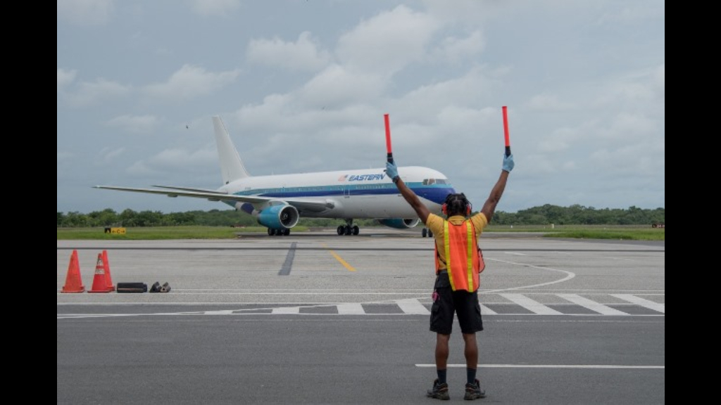 An Eastern Airlines flight landing at the Cheddi Jagan International Airport on July 1 with 67 Guyanese onboard. Photo: Department of Public Information